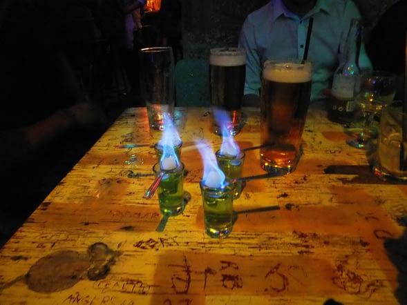 Flaming shots of absinthe